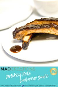 ribs with barbecue sauce on a white plate