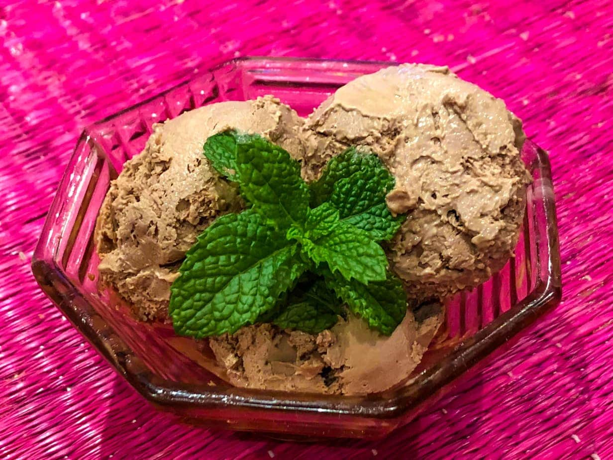 chocolate and mint ice cream in a glass bowl with fresh mint
