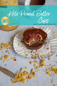 Mad Creations Keto Peanut Butter Cups on a patty cake liner with a bite out of it
