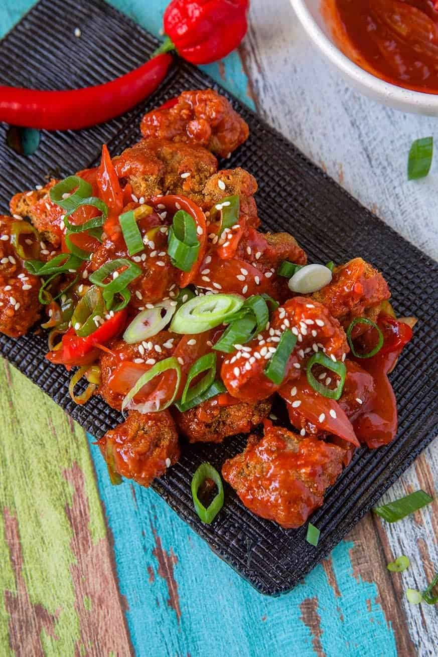 Mad Creations Keto Sweet and Sour Pork on a black plate