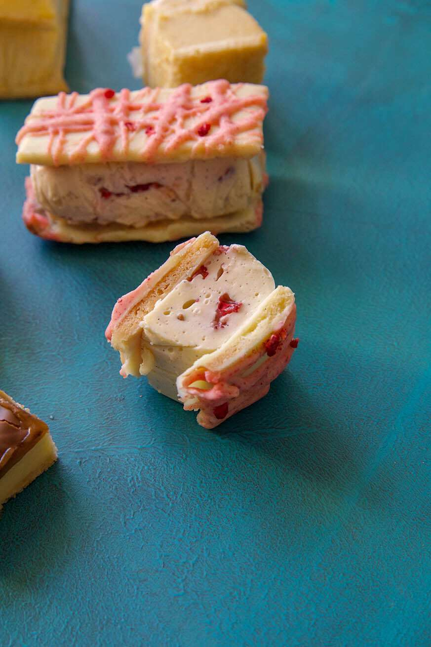 Mad Creations Monte Carlo Low carb Vanilla Slice with other varieties on a blue background