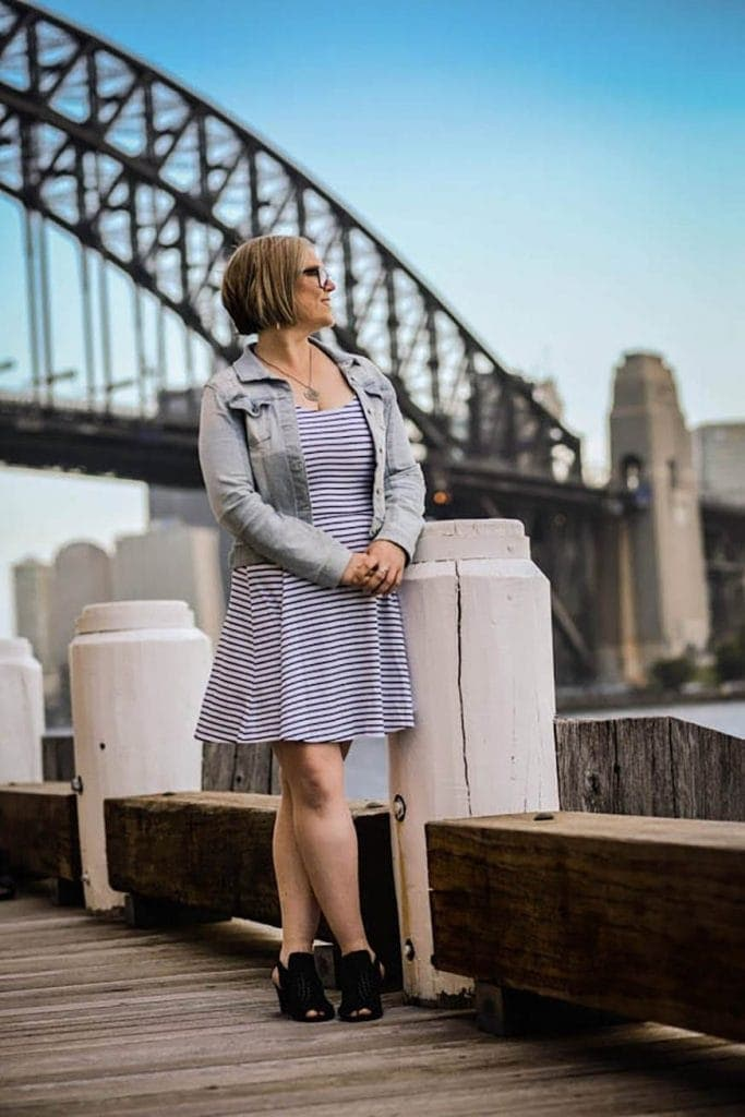Nicole Mahoney standing in front of Sydney Harbour