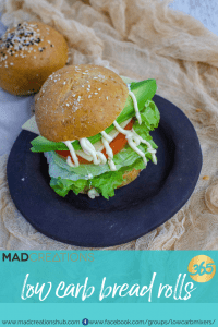 low carb bread roll on a plate filled with salad