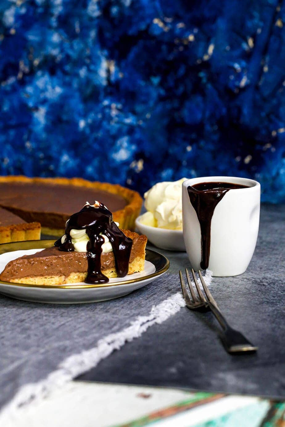 chocolate bavarian pie and sauce on grey table