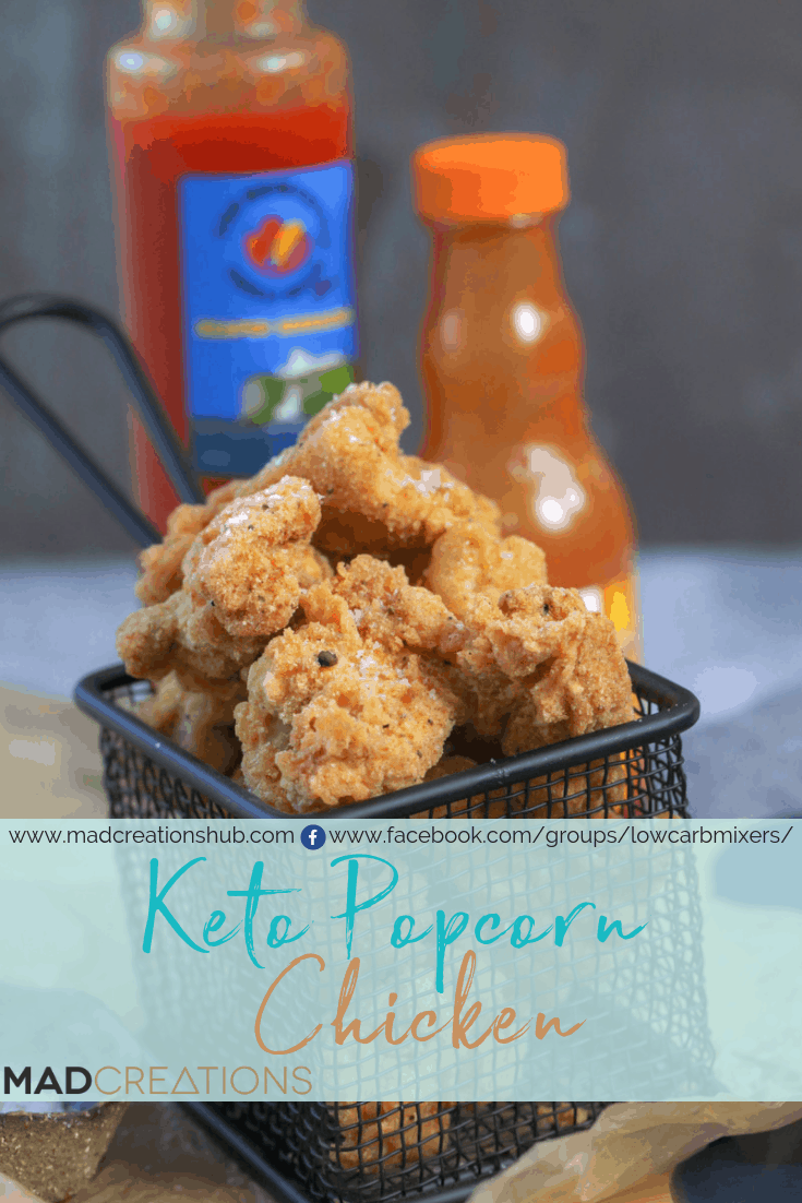 Keto Popcorn Chicken in basket with hot sauces