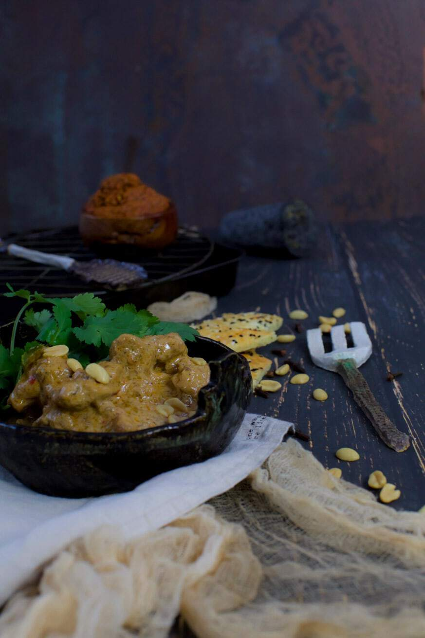 Curry chicken in a black bowl