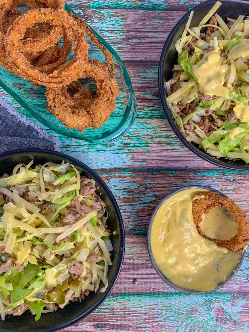 two bowls of salad with onion in a separate bowl