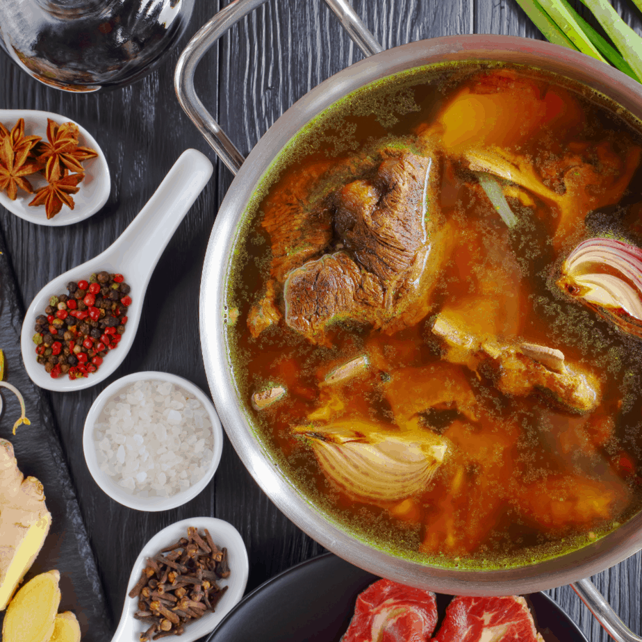 broth with spices in a pot